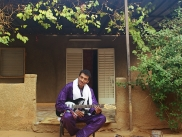 Bombino in the yard of his house in Niamey