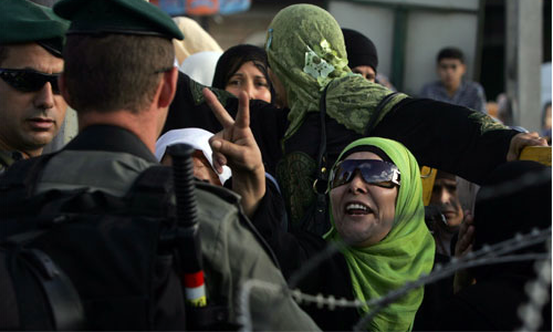 Woman protesting at Israeli Checkpoint