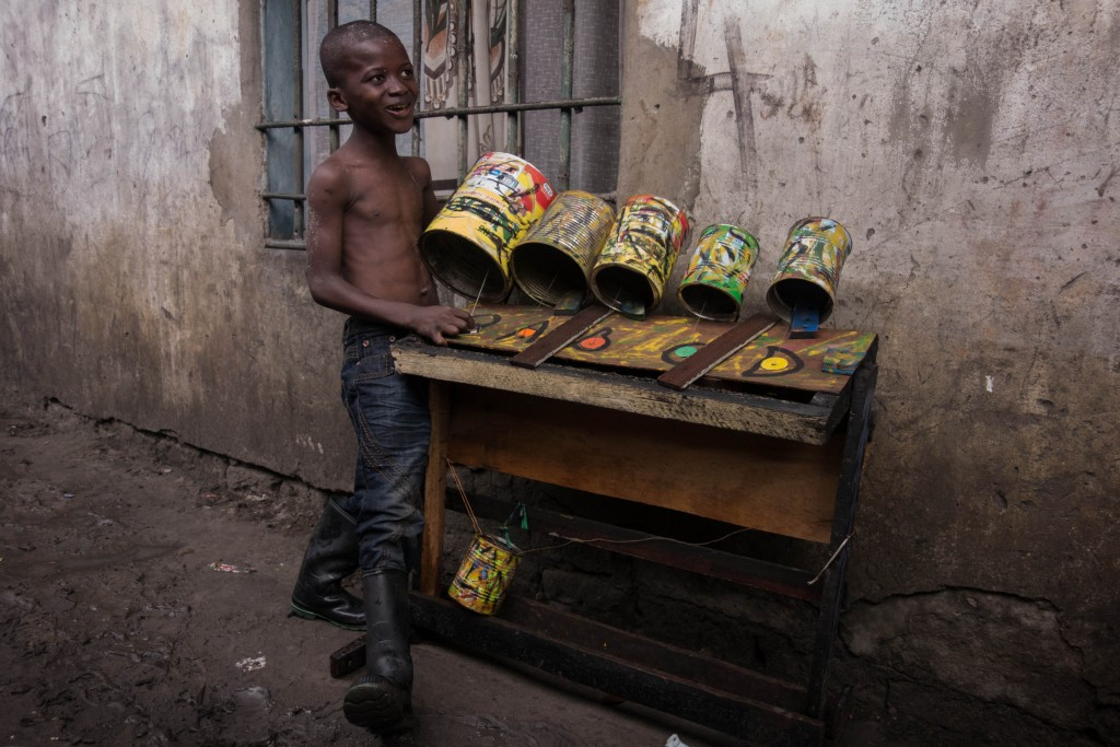 Boy with recycled instrument, Kinshasa (c) Renaud Barret