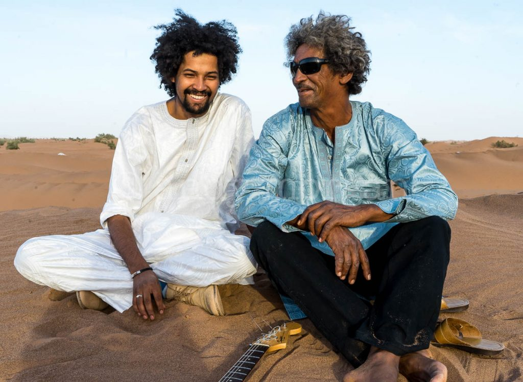 Sadam from Imarhan with Ibrahim from Tinariwen at Taragalte Festival 2017